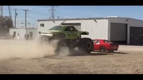 Bystander Captures the Gas Monkey Monster Truck Running Over a 2015 Hellcat!