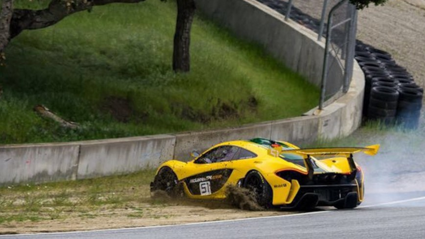 NEAR CRASH - Mclaren P1 GTR Spins Out at Laguna Seca Corkscrew