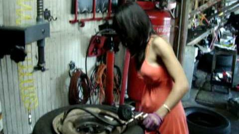 Lady who changes tires in a dress, she is hired